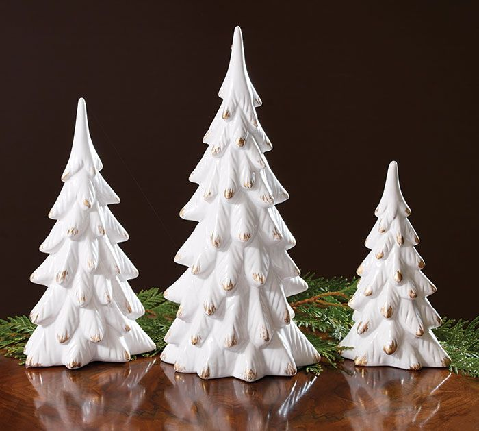"#burtonandburton White Christmas tree décor.<br>Solid white porcelain tree shape with gold brushed tips.<br><br>Small: 8 1/2""H X 5""W X 3 1/4""D<br>Medium: 12 1/2""H X 6 1/2""W X 5""D<br>Large: 16""H X 7 1/2""W X 5 1/4""D<br>Set of 3."