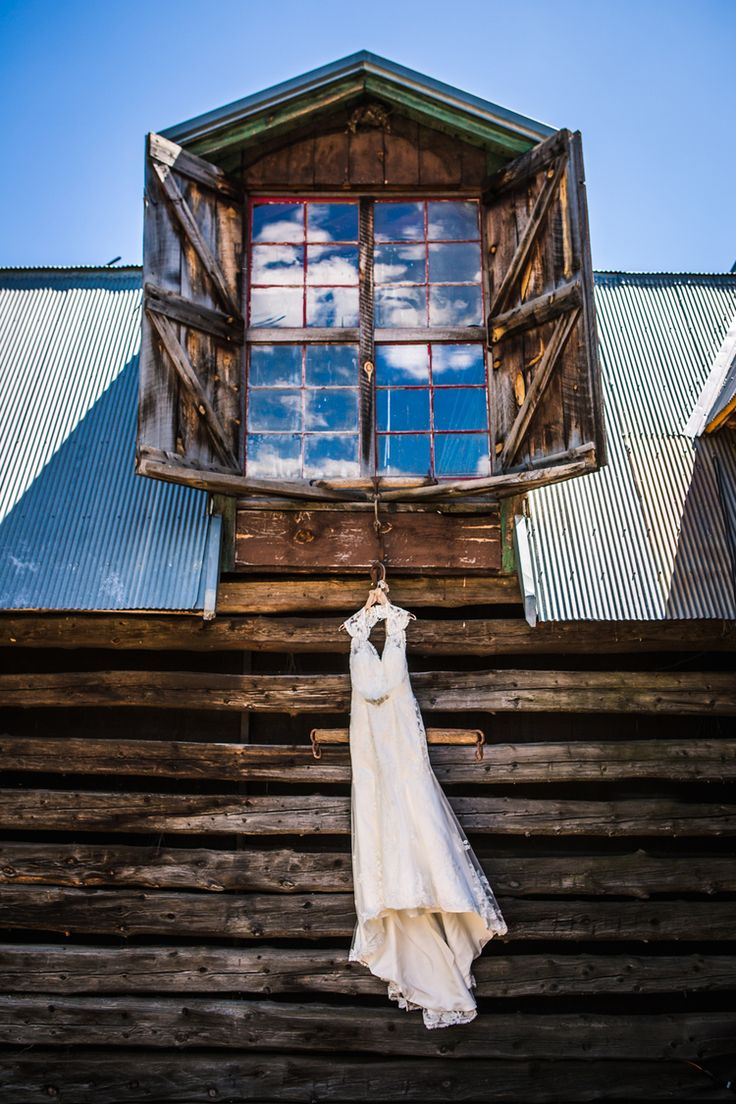 Wedding dress hanging at The Barn at Evergreen Memorial. Photographed by JMGant Photography