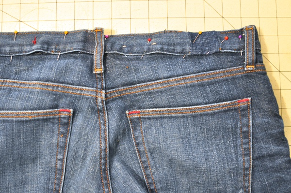 Expanding waist band in jeans. Great idea! Brand label will hide it but I never wear my shirt tucked in anyway.