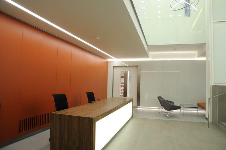 Light + Design - 50 George Street. Opal Line of Light Backlit Reception Desk