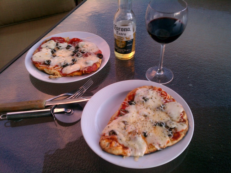 Super Easy Grilled Pizza...Our favorite summer meal. We use tandori nann bread for the crust...any variety of toppings...fresh mozarella cheese, and fresh herbs from the garden. Cook on lower rack of bbq grill....when crust is crispy, move to upper rack to melt cheese. Add more pizza to lower rack...and in a few minutes, the top pizza is done.