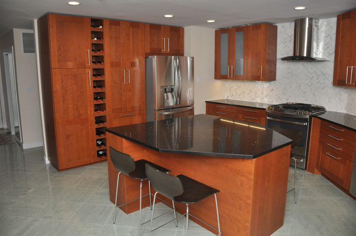 "This IKEA kitchen has GRIMSLÖV doors in medium brown. We helped our customers fit 90"" cabinets under a 95"" ceiling on both sides of the kitchen."