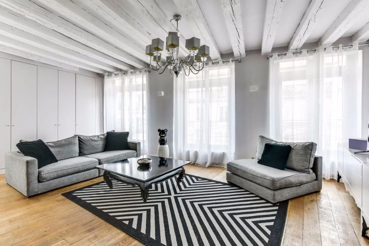 A stone's throw from place des Vosges, this 85m2 2 bed apartment is on the 3rd floor (no lift) and comprises o large 45m2 lounge (S/W facing) o fully equipped kitchen with breakfast bar o 2 well-sized bedrooms with good storage space o bathroom with bath and shower o bright and light-filled with air conditioning,…