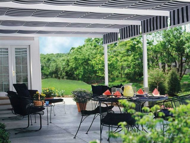 Awnings   ShadeTree Retractable Awnings Provide Shelter For Sun Baked Patios