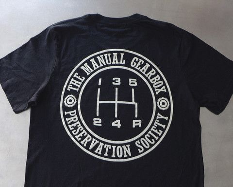 """The Curb Shop - T.M.G.P.S Insignia T-Shirt With some new items available—including """"The Manual Gearbox Presentation Society""""— Curb has graciously extended a 25% discount code applicable to original Curb items* to Petrolicious readers. Simply enter """"DRIVETASTEFULLY"""" at checkout!"""