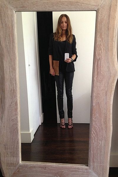 """""""This solid teak mirror in my hallway is getting a lot of use lately! Heading to a shoot wearing black silk jacket, silk tank, leather pants and leopard & leather clutch - all Little Joe Woman with Azzedine Alaia heels."""""""