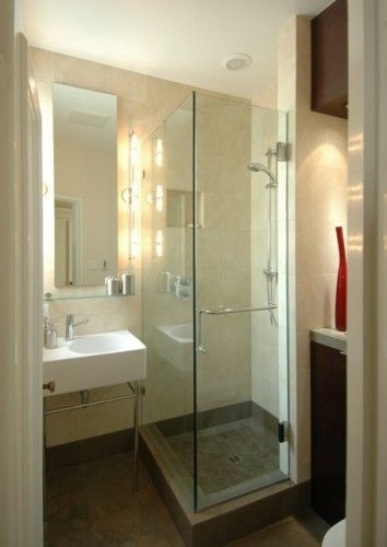 Glass shower makes a bathroom look bigger. Small space solution.