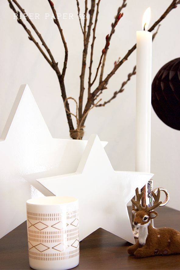 Get a scandinavian style to your Christmas mantle decorations with a muted colour palette of black, white and grey. Create contrast with metallics like copper which is trending right now. Add whimsy with woodland creatures like reindeer and ambience with candles.
