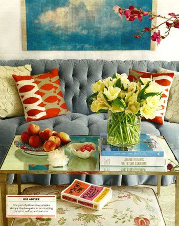 velvet tufted sofa with tangerine & turquoise accents.