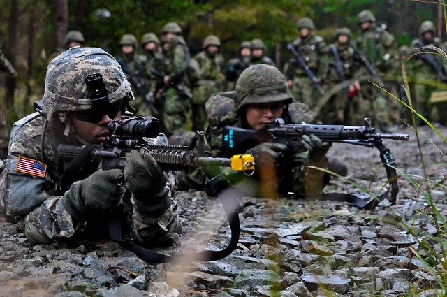 U.S. Army Pfc. Kharon L. Mitchell, left, a combat engineer with the 3rd Platoon, 66th Engineer Company, 2nd Brigade Combat Team, and Japan Ground Self-Defense Force (JGSDF) Staff Sgt. Ichiro Umemoto establish perimeter security during improvised expl self defense moves