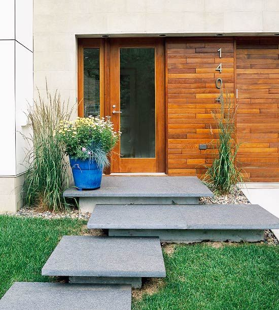 Guide guests from the street or drive to the front door with a clearly marked and well-maintained path that is 3-4 feet wide so two people can walk side-by-side. Add interest and impress your guests with custom walkway as seen here.