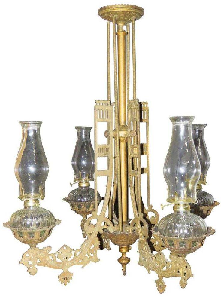 1800's Four Lamp Saloon Chandelier. Ornate cast iron