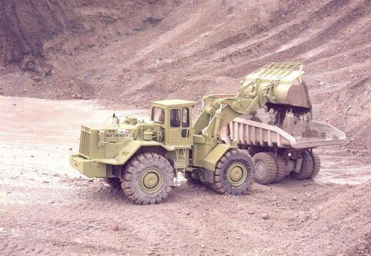 New Zealand's Baker Construction owned two Terex 72-81s. This is the first to go into service and is seen depositing a load of Waitaki Basin gravel into a Ministry of Works Caterpillar 769B rear dump. Note the chrome exhaust stack, a class touch!