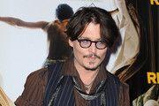 Johnny Depp attends the 'Rum Express' Paris Premiere at Cinema Gaumont Marignan on November 8, 2011 in Paris, France.