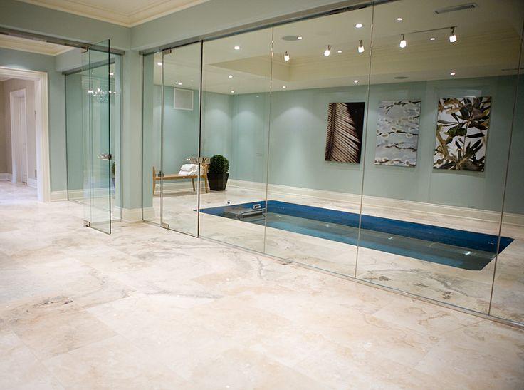 #travertine tile basement with indoor pool