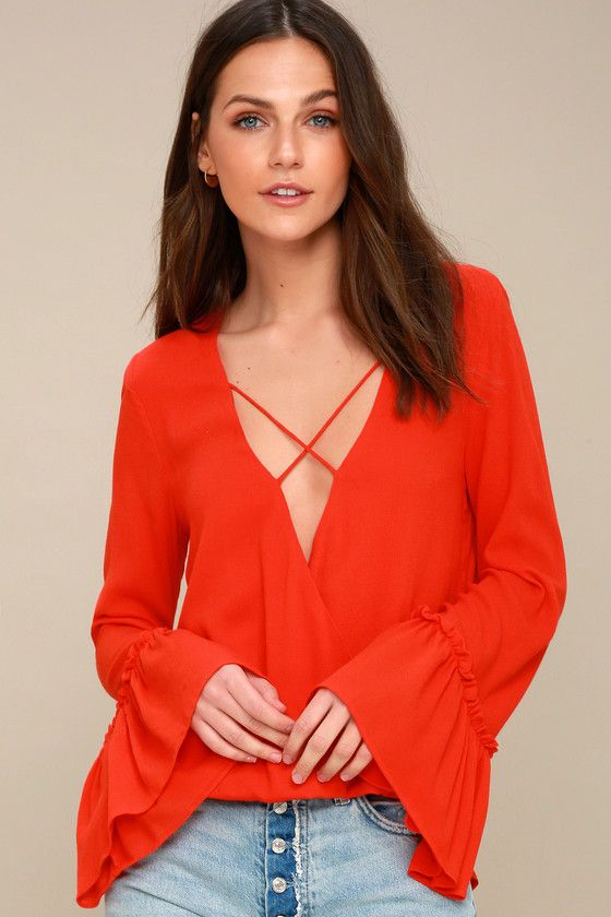 Lulus Exclusive! Add a little Boho flair to your look with the Ryland Coral Red Long Sleeve Top! Breezy woven rayon forms long, flounce sleeves, a strappy, plunging neckline, and a relaxed, surplice bodice. Looping high-low hem finishes off this breezy look!