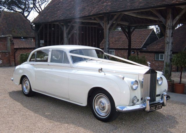 classice white rolls royce car. would love to ride in this after we get married!
