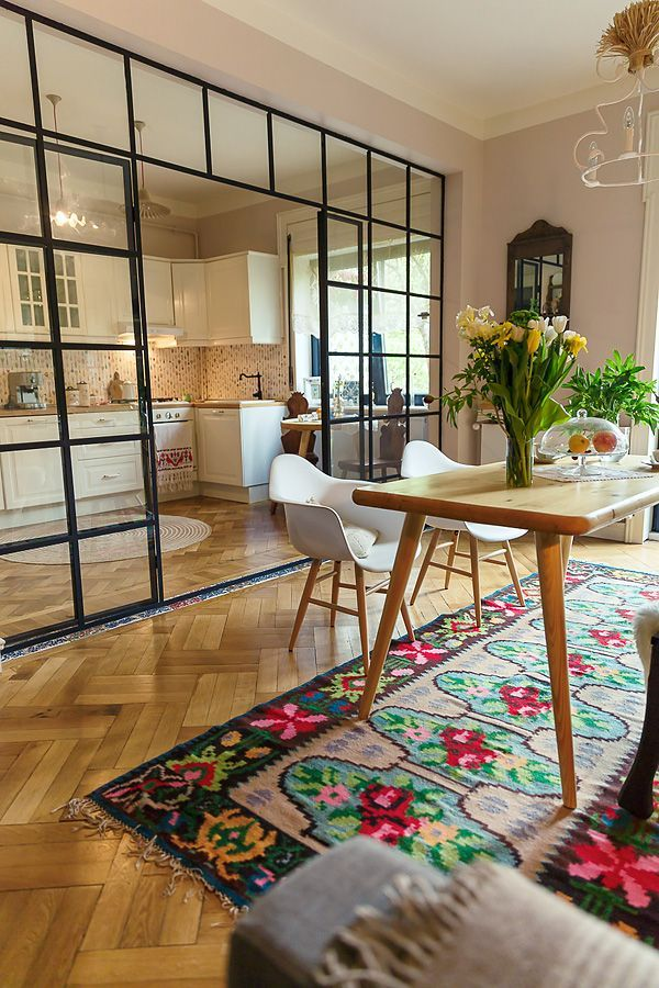 kitchen and dining separated by beautiful glass panels | chevron hardwoods, antique rug