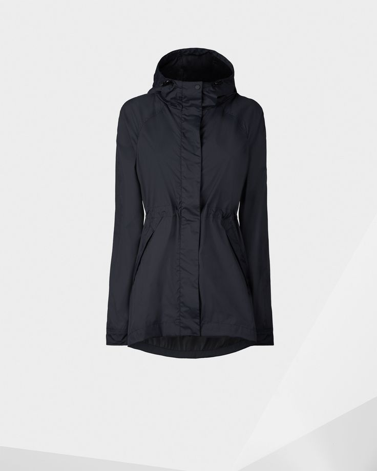 A packable women's cagoule crafted from lightweight, crease-resistant material