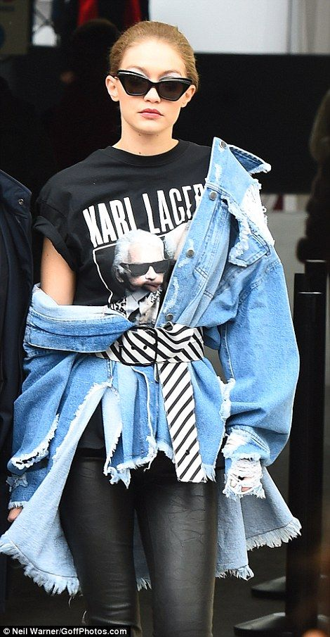 Denim days: The US stunner paid tribute to Chanel designer Karl Lagerfeld following the show as she donned a picture emblazoned tee of the creative while draping an oversized denim jacket around her