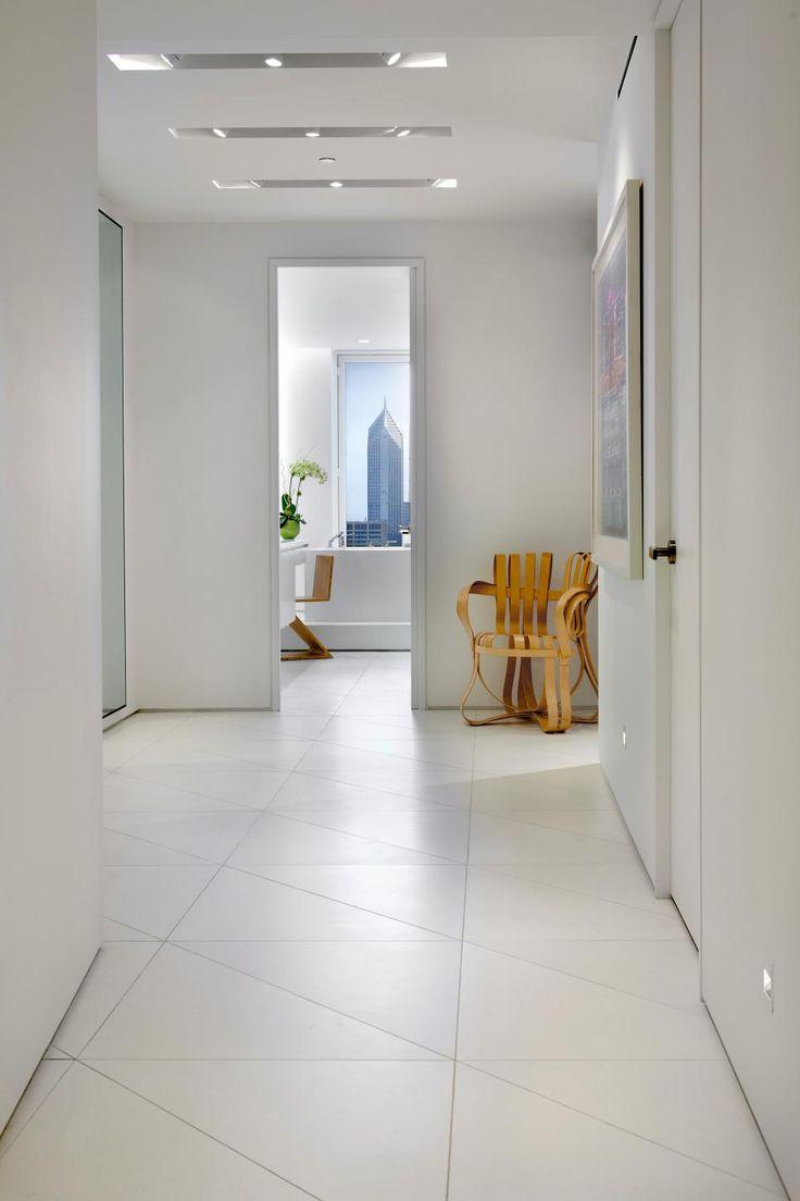 modern white hallway with triangular tile floor