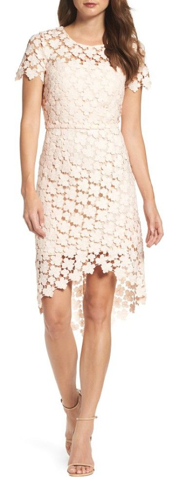 laguna dress by Vince Camuto. Soft, romantic lace gets architectural in the crisscrossed construction of this modern cocktail sheath.