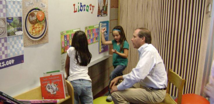 Tom Udall at Afterschool Program in Farmington learning Math