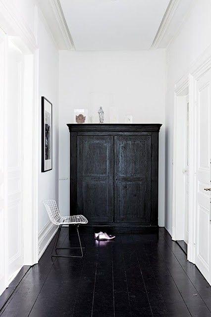 Black wooden floor and cabinet