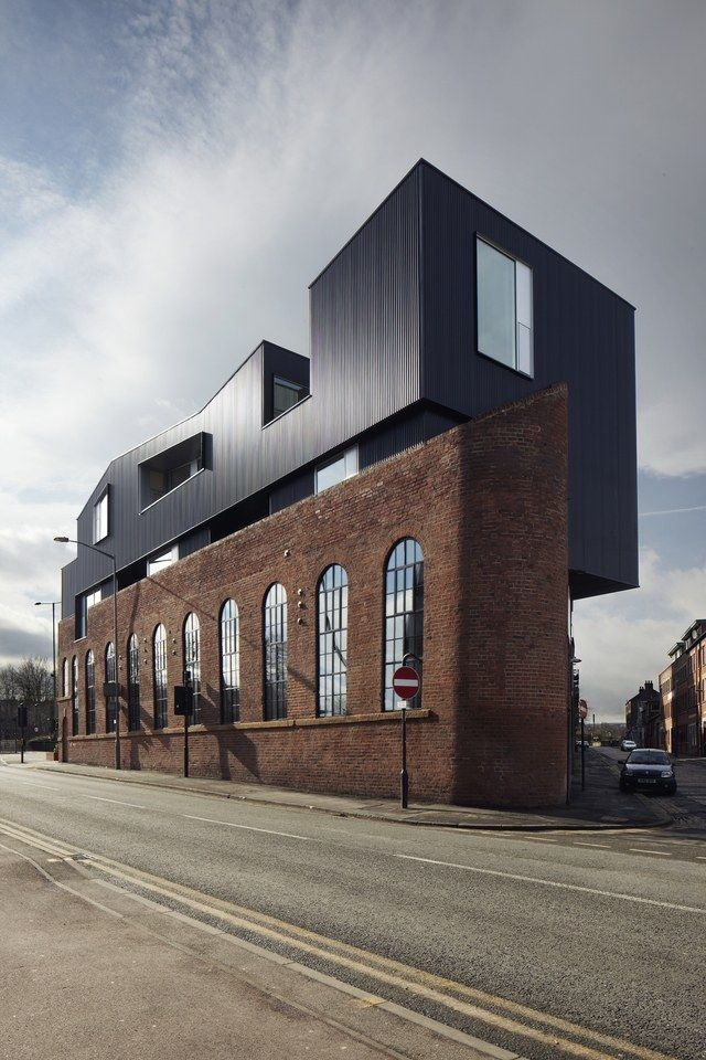 Completed in 2012, this powder-coated-steel addition transformed a brick warehouse at 192 Shoreham Street in Sheffield, England, from a relic of the city's industrial past into a vibrant commercial space with offices, a restaurant, and a bar. | archdigest.com