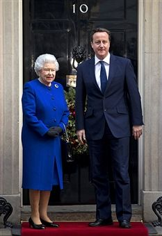 Queen Elizabeth II is greeted by British Prime Minister David Cameron on the doorstep of Number 10 Downing Street as she arrives to attend the Government's weekly Cabinet meeting on December 18, 2012 in London, England. The Queen's visit to the weekly Cabinet meeting as an observer is the first time a Monarch has attended the meeting since Queen Victoria's reign.