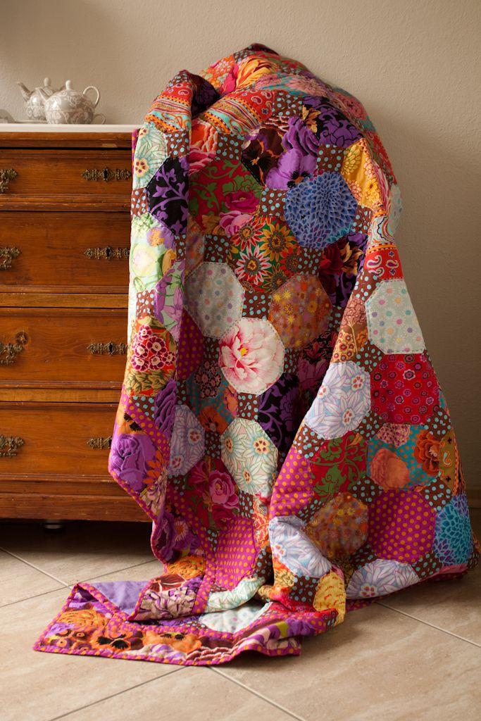 Pretty floral theme scrap quilt - A Snowball quilt using Kaffe Fassett fabrics.