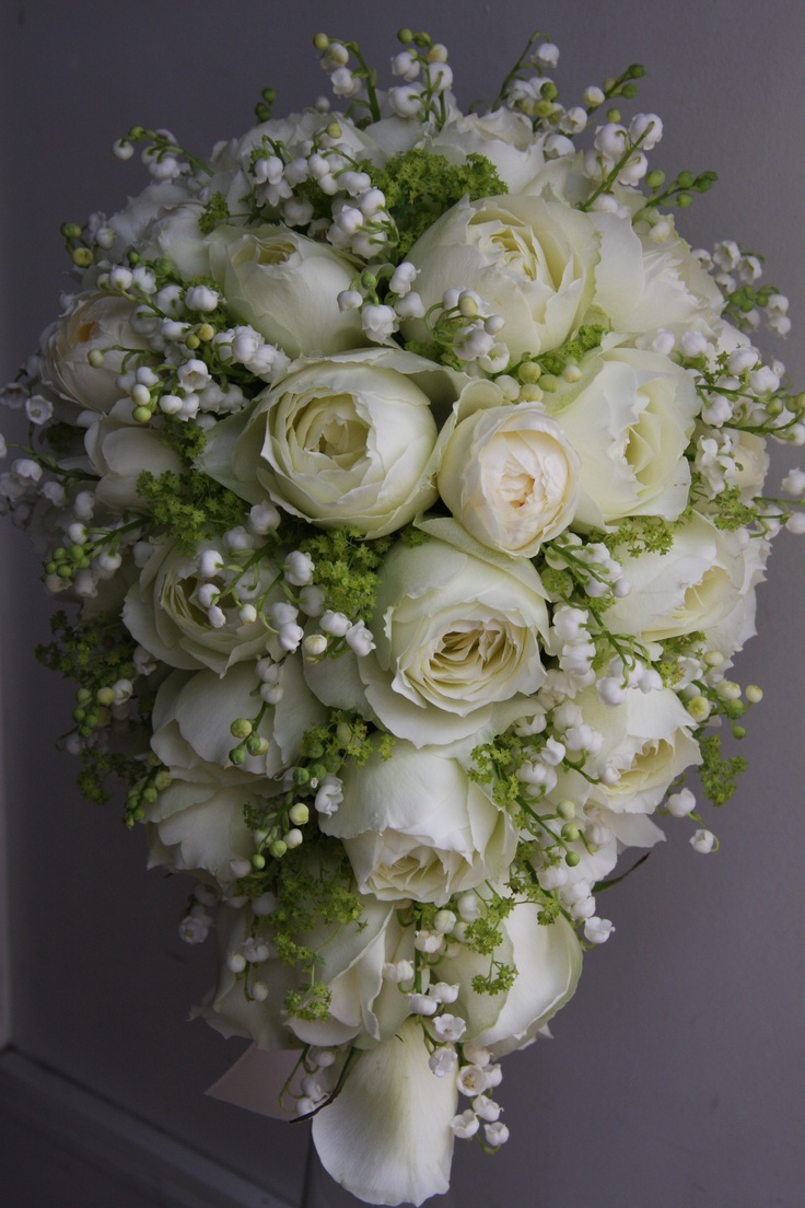 Beautiful Tear Drop Cascade Wedding Bouquet Arranged With Garden Roses Lily Of The Valley Green Foliage