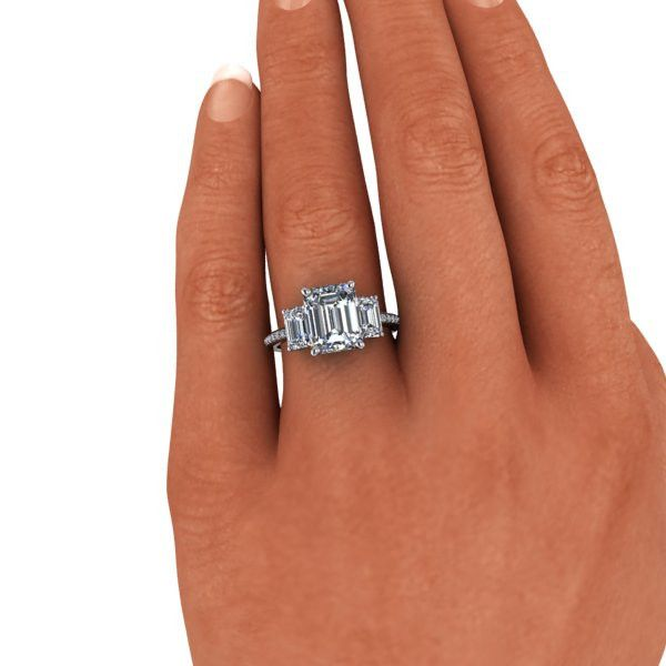 A three stone ring set with three Russian Brilliant emerald cut stones of your choice. Diamonds: 20, G/H SI1, .13 ct Shown with a 3.5 ct center stone size and t