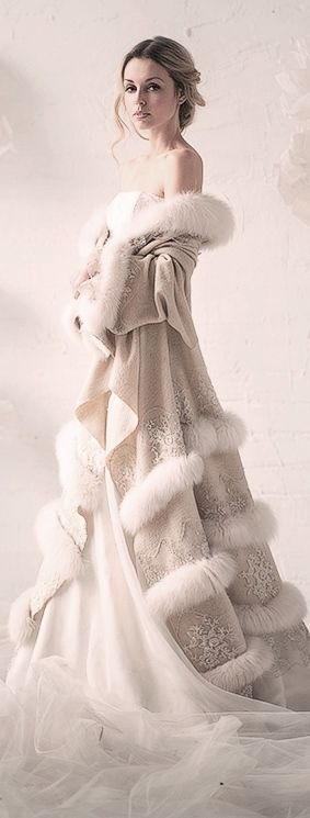 Winter bride beautiful white gown with ivory velvet coat trimmed in fur