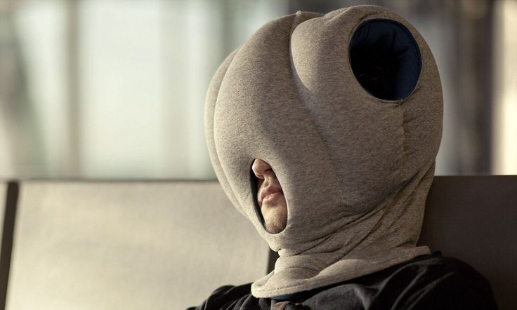 That's a new way to catch 40 winks! Bizarre invention means people can nap anywhere - but it means wearing a 'pillow balaclava'