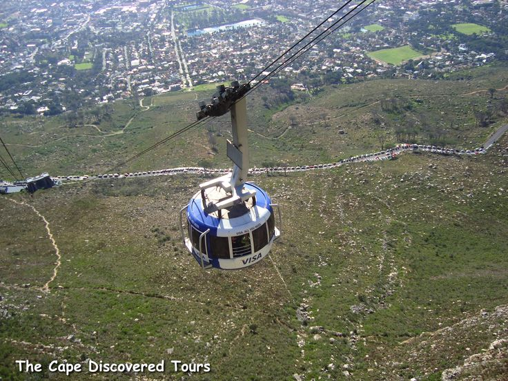 """The Table Mountain Aerial Cableway is a cableway to the top of Table Mountain.  It is one of Cape Town's most popular tourist attractions with approximately 800,000 people a year using the cableway. The """"Rotair"""" cars installed in 1997 and carry 65 passengers each;  the floors of the cars rotate through 360 degrees during the ascent or descent, giving passengers a  panoramic view."""