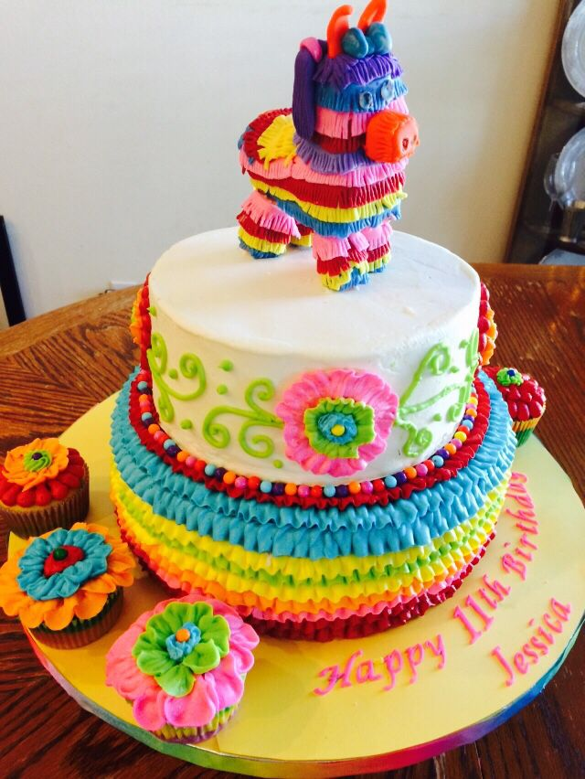Fiesta Mexican Cake made with buttercream frosting. Donkey piñata made by my daughter.