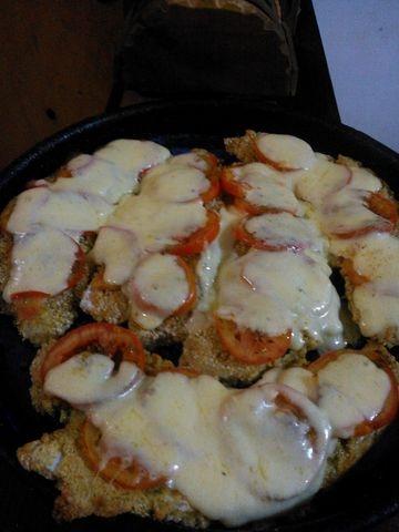 Filet de pescado a la napolitana. Ver receta: http://www.mis-recetas.org/recetas/show/43096-filet-de-pescado-a-la-napolitana
