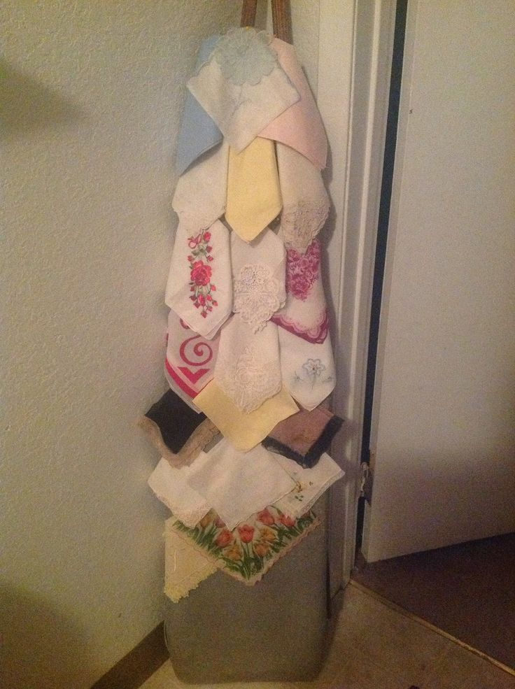 My Aunt Lu displays vintage hankies on her old wooden ironing board...what a great idea for ties or scarves too!