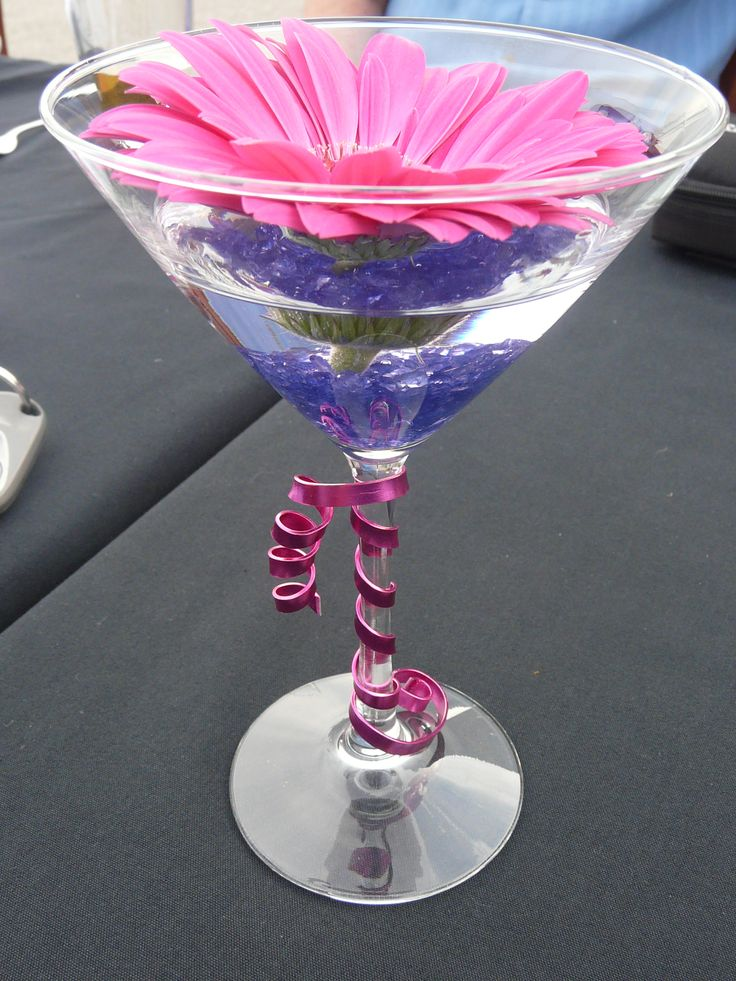 Coral Gerber daisy martini centerpieces, submersible led light at the bottom of the glass with the teal gel crystals.