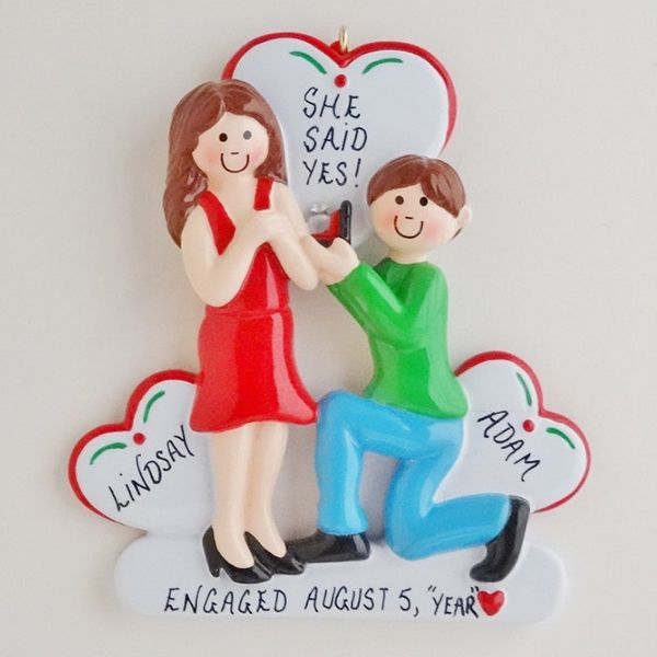 """Commemorate the special occasion with a keepsake """"engaged"""" Christmas ornament."""