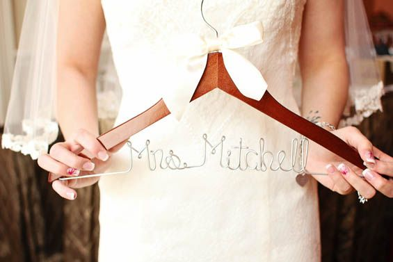 We just love these custom bridal hangers. Such a sweet wedding day touch!