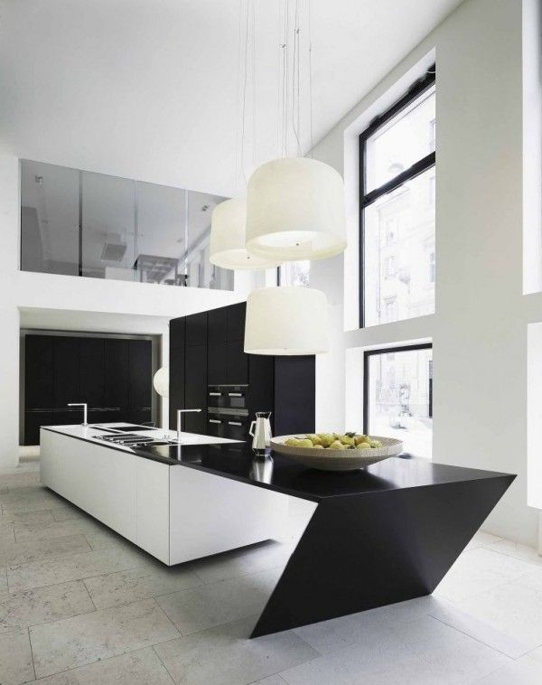 An acute angle in this black and white kitchen adds a surprising amount of interest, as well as practical chopping space.