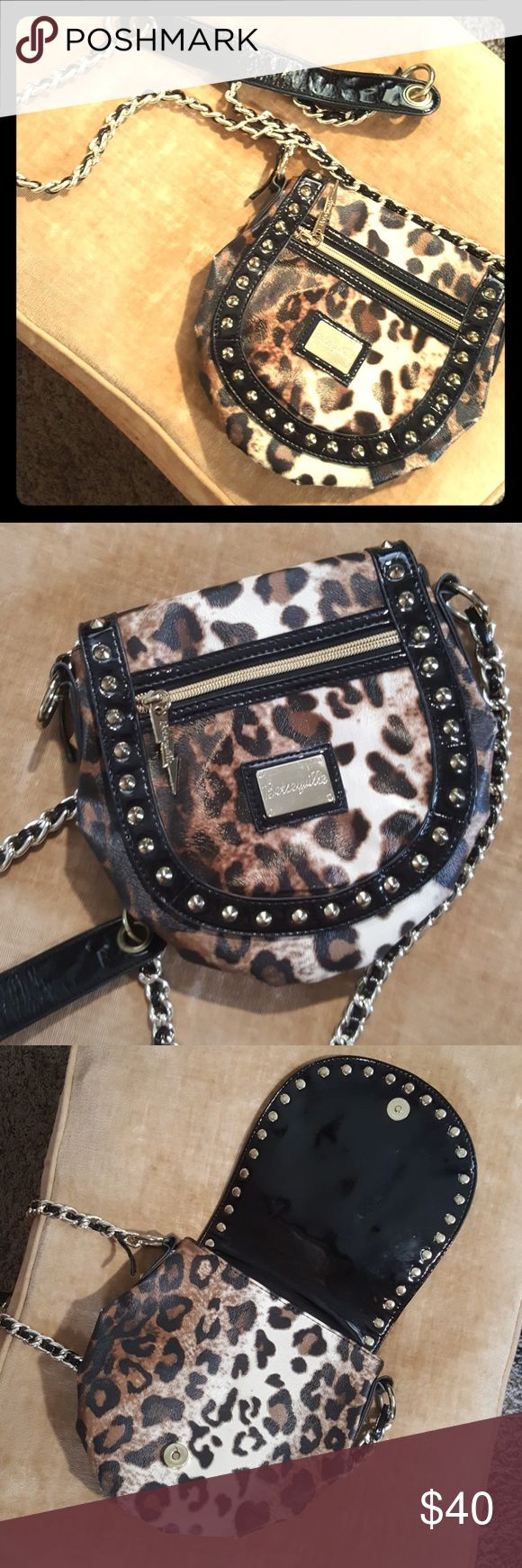 "Betsyville Crossbody bag 💕ADORABLE💜 This is a leather, leopard print Betsey Crossbody with hot pink liner.  So cute and it's lightweight! Perfect for the ""on the go"" girl or a night out on the town.  Excellent Condition, absolutely no sign of wear. 😁 Betseyville Bags Crossbody Bags"