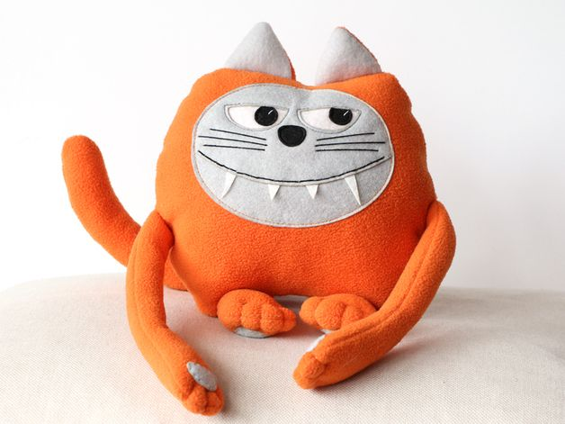 Scary gifts at DaWanda Plush soft toy Monster Cat. Even if it's got big teeth and eyes, it wouldn't scare anyone. It's very soft and friendly. Its orange body emanates with warmth and joy. Orange is the color of positive...