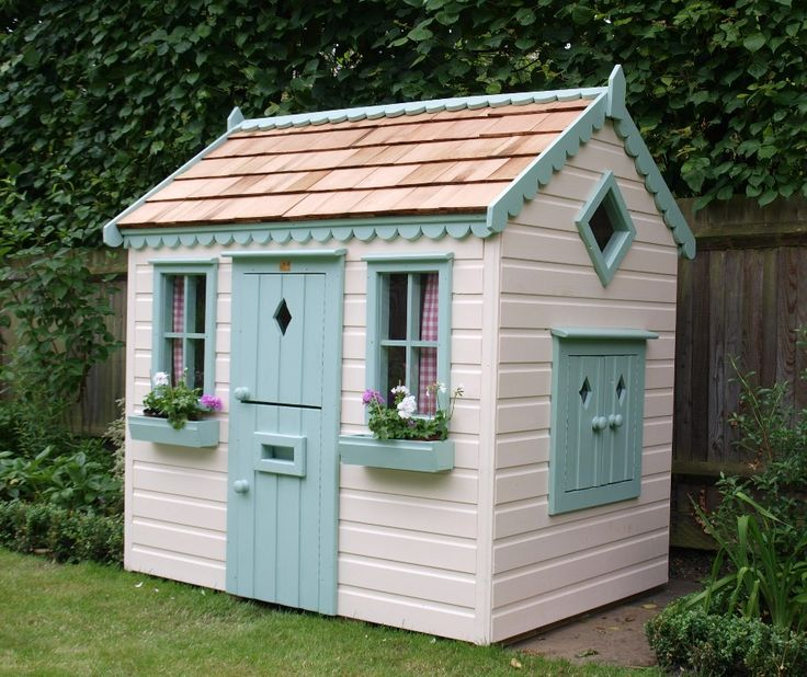 Childrens cottage style playhouse with planted window boxes