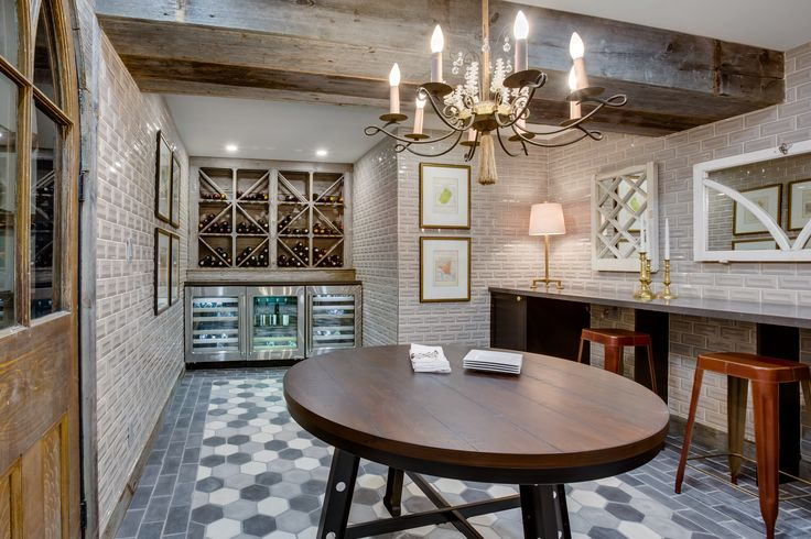 Home To Win - Tour the Wine Cellar; pictures and galleries of the exclusively renovated and designed rooms.