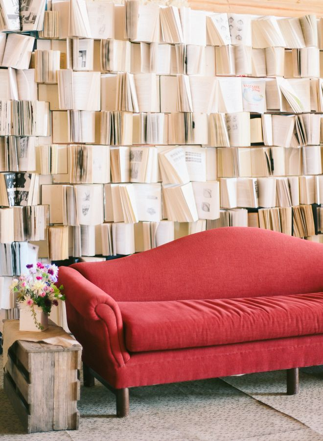 Make your reception feel like a cozy library with comfy seating and a wall of books   J Lucas Reyes