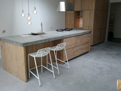 Ikea Kitchens with wooden doors from Koak Design [look at the thickness of that concrete countertop!!!]