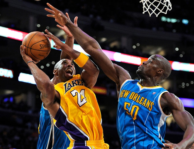 Los Angeles Lakers guard Kobe Bryant, left, goes up for a shot as New Orleans Hornets center Emeka Okafor defends. 2011 Playoffs NBA